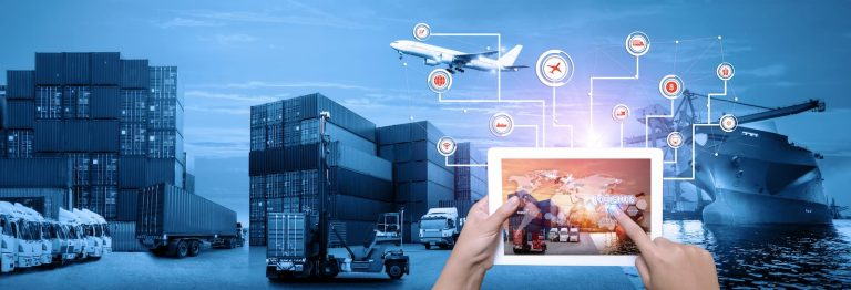 A person holds a tablet bursting with information against a blue background featuring different modes of freight including a docked container vessel, dozens of stacked containers and HGVs in the port as a cargo plane flies above